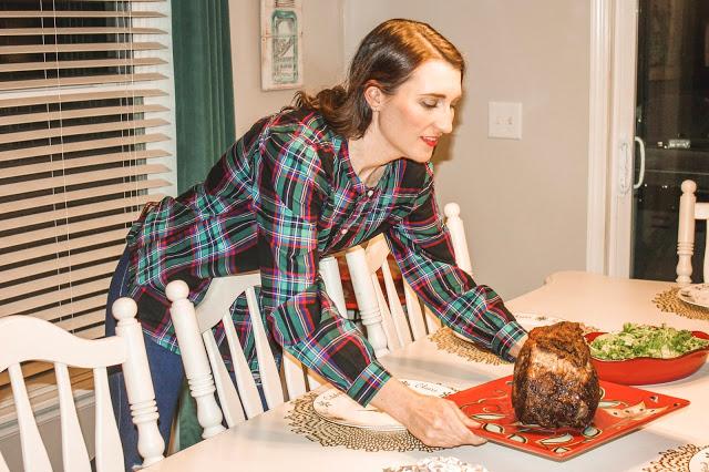 Laura MIntz serving standing rib roast or prime rib