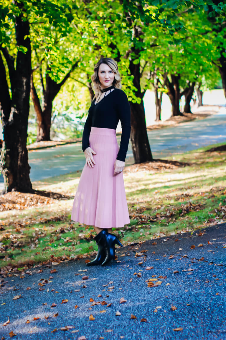 Pink Pleated Midi Skirt with Black Bodysuit