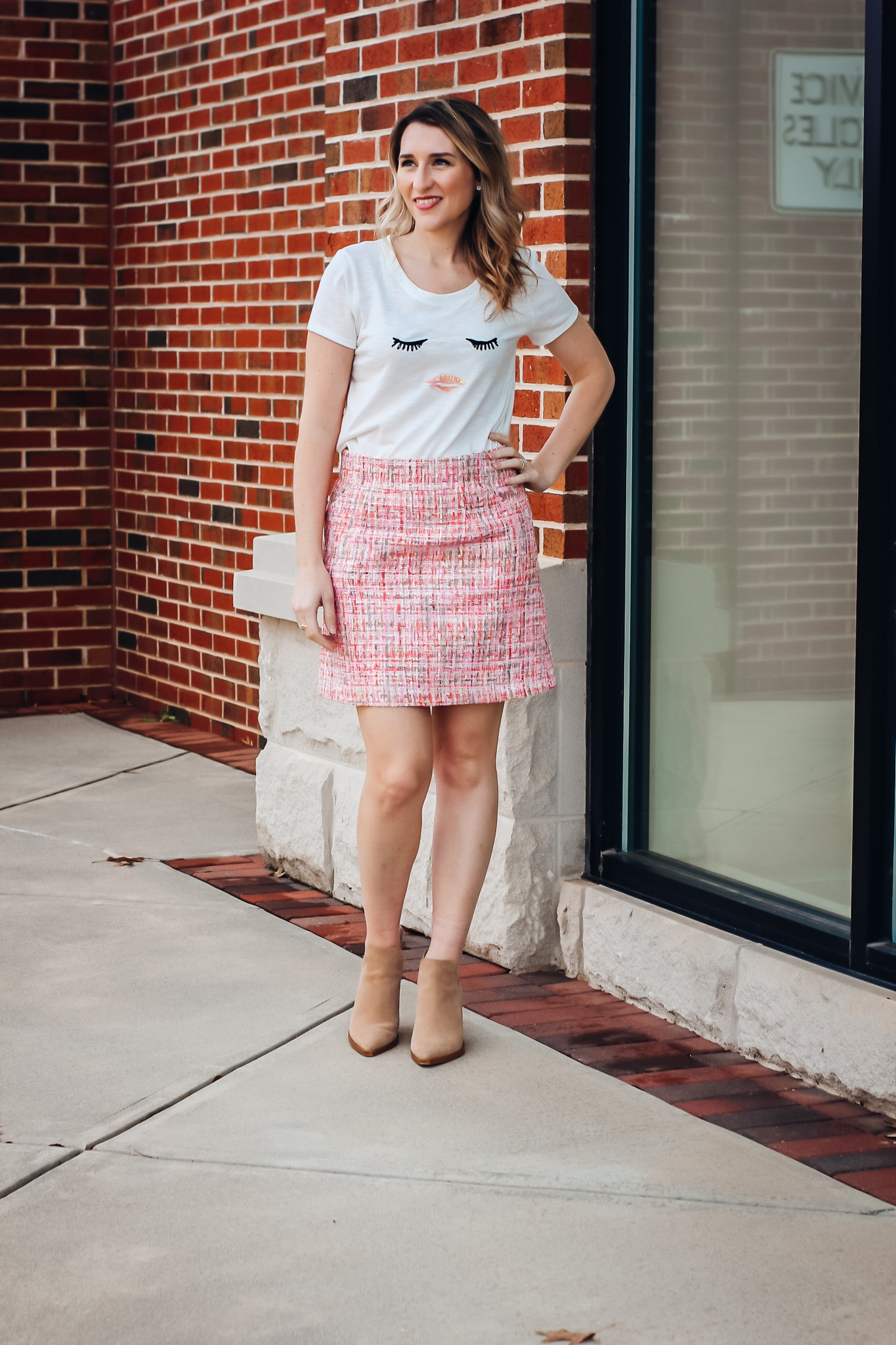 Classic Pink Tweed Skirt styled with eyes and lips graphic tee and tan booties