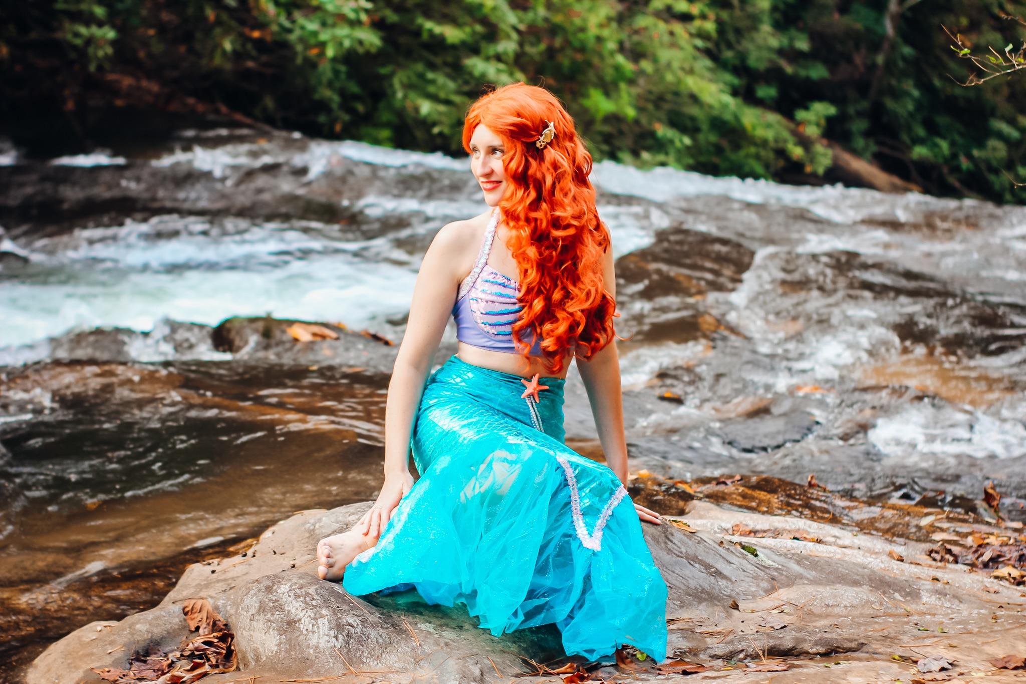Little Mermaid Halloween Costume Sitting on Rock