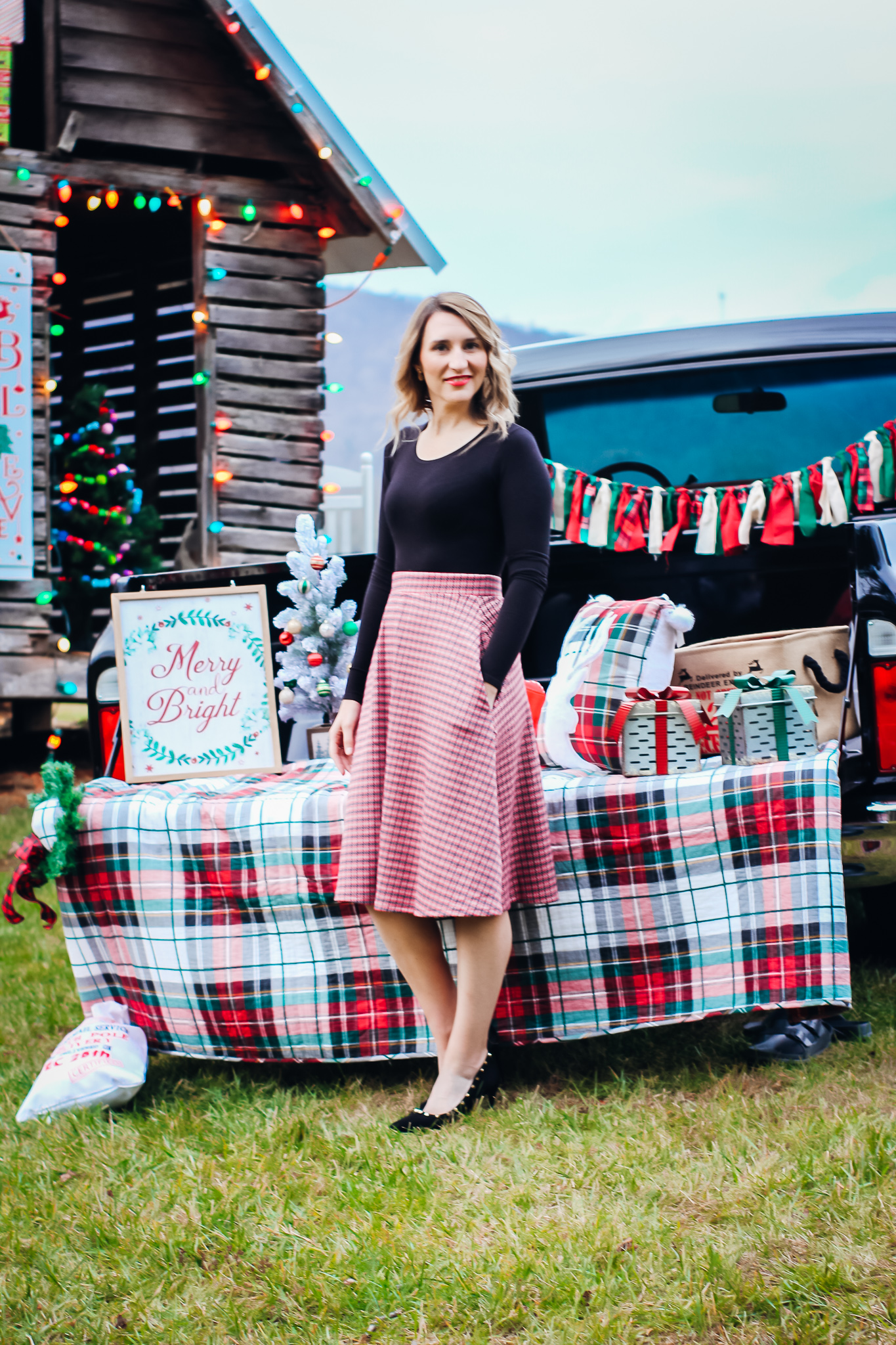 Laura Mintz-Affordable Holiday Looks-Red Plaid Skirt-Christmas Truck