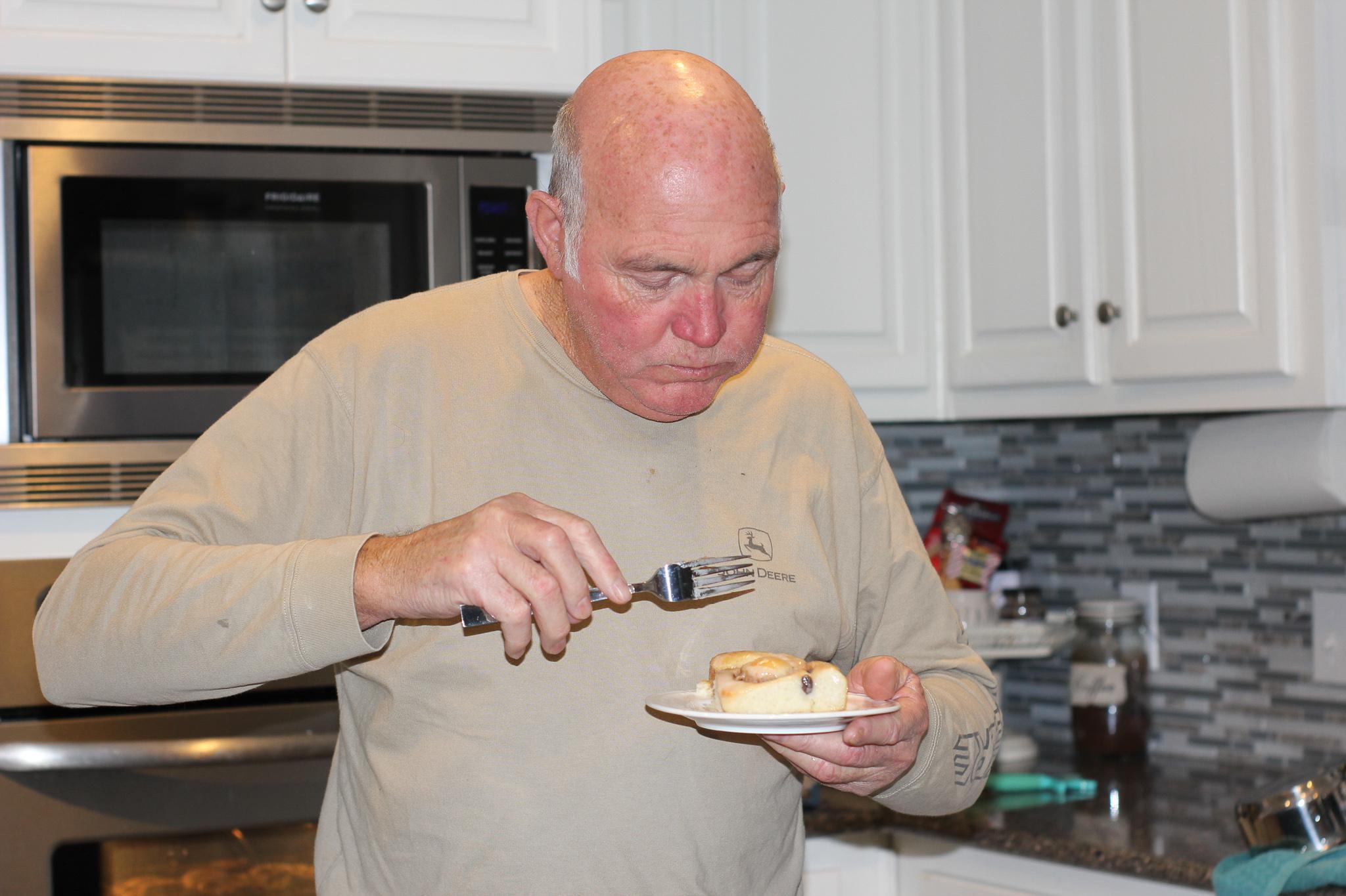 Daddy eating cinnamon rolls